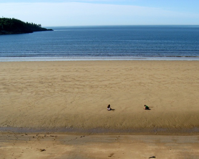 Two people on the New River Beach